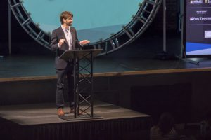 Guest speaker at endeavor summit standing on stage