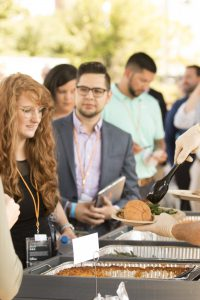 Attendees of endeavor summit receiving their food from a buffet
