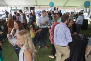 Endeavor summit attendees networking around standing tables